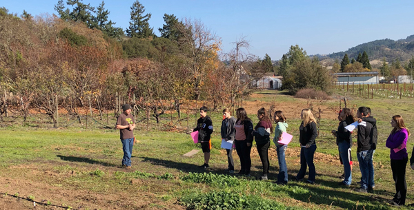 students standing in vineyard